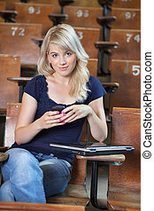 College Girl Text Message - Portrait of young happy college...
