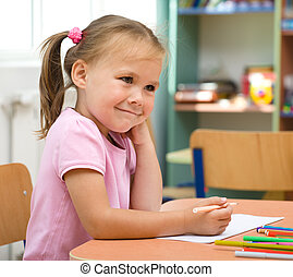 Little girl is drawing with felt-tip pen