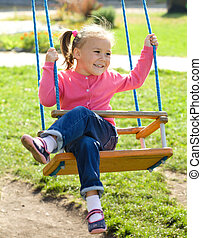 Cute little girl on swing