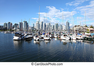 Vancouver BC waterfront skyline & sailboats.