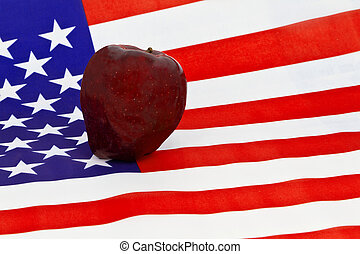 Education Across the Nation - A red apple, symbol of...