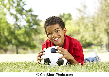 Boy In Park With Football
