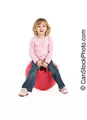 Young Girl Having Fun On Inflatable Hopper
