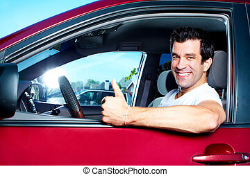 Driving. - Happy smiling man in new car. Driving.