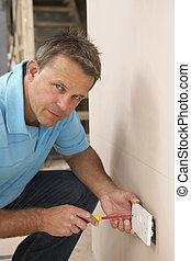 Electrician Installing Wall Socket
