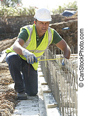 Construction Worker Laying Foundations