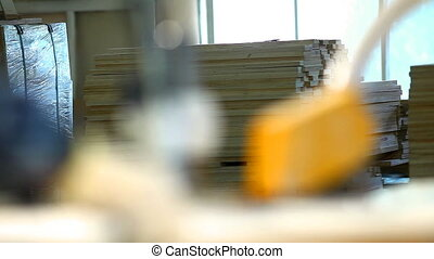 plywood factory - focus from circular saw to window -...