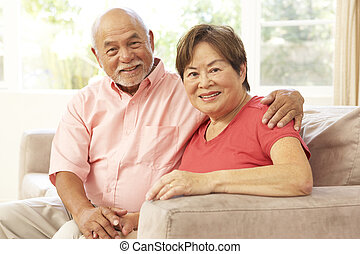 Senior Couple Relaxing At Home Together