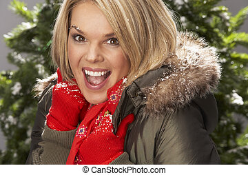 Fashionable Woman Wearing Parka Coat And Scarf In Studio In...