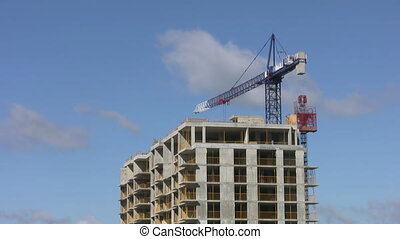 Blue construction crane. Timelapse. - A blue crane swings...