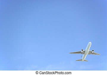 Commercial Airplane Flying Against A Blue Sky