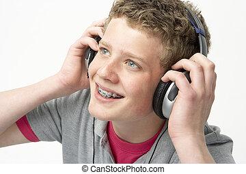 Portrait of Smiling Teenage Boy Listening to Music