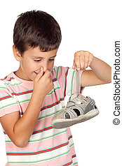 Child with a stuffy nose taking a sandal - Child with a...