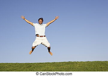 Young man jumping in air