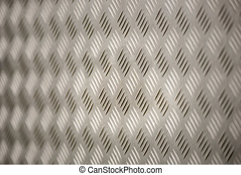 Metal background with diamond pattern and diminishing...