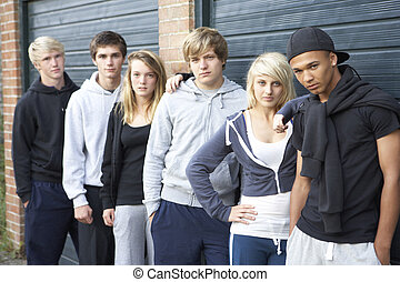 Group Of Teenagers Hanging Out Together Outside