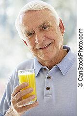 Man Smiling At Camera And Drinking Orange Juice