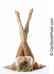 Young Woman Lying Down With Her Legs In The Air