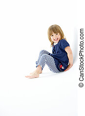 Young Girl Sitting In WhiteStudio