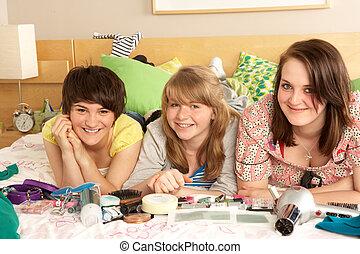 Group Of Teenage Girls In Untidy Bedroom