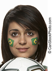 Young Female Football Fan With Brazilian Flag Painted On...