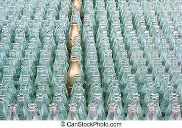 Ring toss - Glass bottles lined up in rows for a midway game