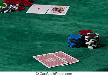 Poker game - Cards and chips in a Texas hold em poker game