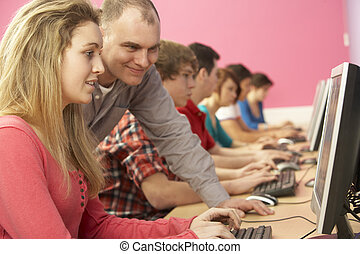 Teenage Students In IT Class Using Computers In Classroom...