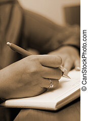 Journal entry - A woman makes an entry in his diary