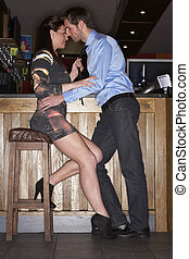 Young couple flirting at bar
