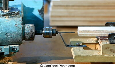 Drilling a plywood from side at wood factory - Drilling a...