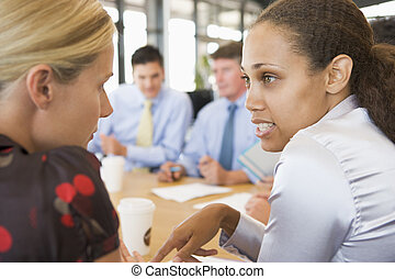 Businesswomen Talking To Each Other During Meeting