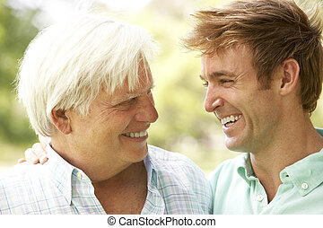Portrait Of Senior Man Talking To Adult Son