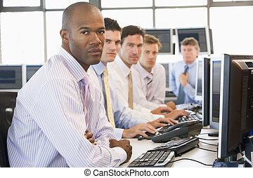 Team Of Stock Traders At Computers