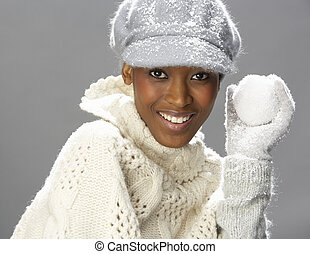 Fashionable Woman Wearing Knitwear And Cap In Studio