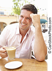 Young Man Enjoying Cup Of Coffee In Caf?
