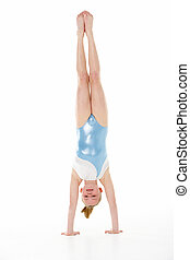 Studio Portrait Of Young Female Gymnast Doing Handstand