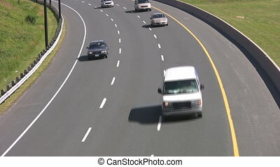 Traffic on highway curve. Closeup. - Traffic comes around a...