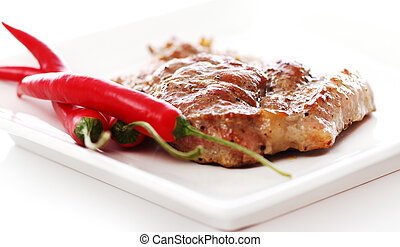 Grilled steak and chilli pepper