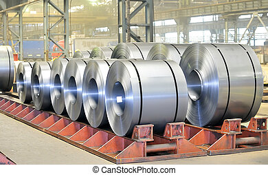 rolls of steel sheet in a warehouse