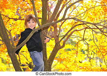 Little girl climbed on tree