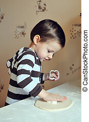 The child the scullion - The child on kitchen prepares dough...