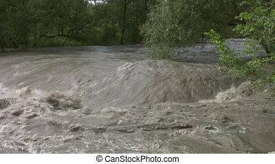 Raging flood river Upstream shot - Wide angle view of fast...