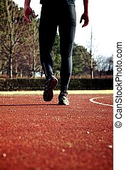 Athlete walking on a sportstrack after finished workout