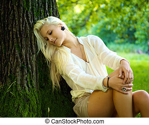 Beautiful girl relaxing - A young beautiful girl is relaxing...