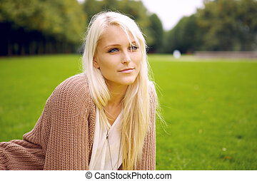 Peaceful woman sitting in a park