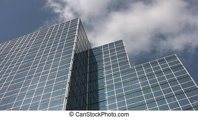 Blue office tower - Blue office building with clouds moving...