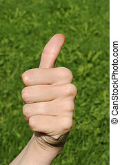 all right, left hand sign, grass - detail of a young...