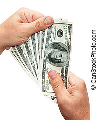 Money in hands - Mens hand holding US dollars, the image...