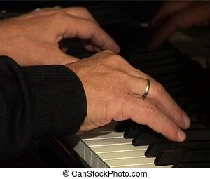 hands of pianist on the classical concert